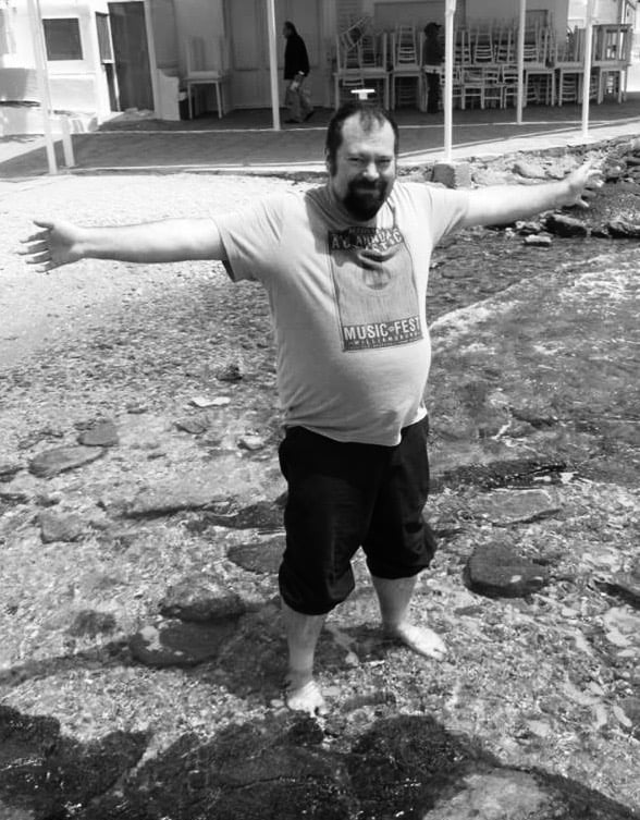 Brent starting up his stride for a creepy uncle hug. Stay out of the water, kids.